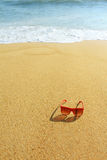 Red sunglasses on the beach Royalty Free Stock Photo