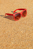 Red sunglasses on the beach Royalty Free Stock Image