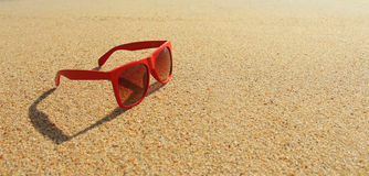 Red sunglasses on the beach Royalty Free Stock Images