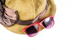 Red sunglasses and beach hat. Isolated on white background Stock Photo