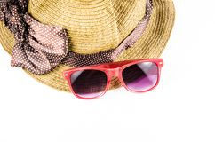 Red sunglasses and beach hat. Isolated on white background Royalty Free Stock Images
