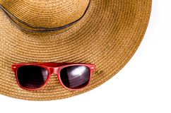Red sunglasses and beach hat isolated on white. Background Royalty Free Stock Photography