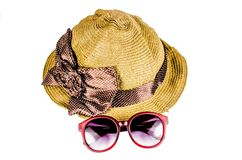 Red sunglasses and beach hat isolated on white Stock Photos