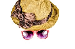 Red sunglasses and beach hat isolated on white. Background Stock Photos