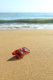 Red sunglasses on the beach Stock Photos