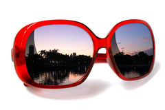 Red sunglasses isolated with city view sunset Stock Images