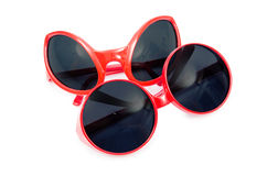 The red sunglasses isolated on white Stock Photos