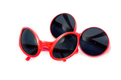 The red sunglasses isolated on white Royalty Free Stock Photos