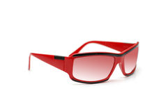 Red sunglasses isolated on the white background. Red sunglasses isolated  on the white background Royalty Free Stock Photo