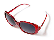 Red sunglasses . Red sunglasses on white Royalty Free Stock Image