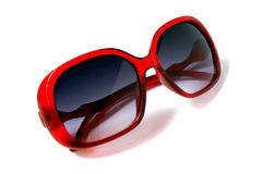 Red sunglasses . Red sunglasses on white Royalty Free Stock Photos