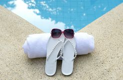 Red sunglasses white shoes towel pool blue Royalty Free Stock Photography