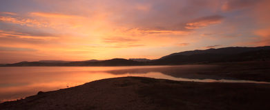 Red sunlight panorama over lake Stock Photo