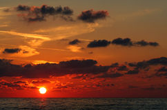 Red sunrise on the black sea. Sunrise on the black sea with beautiful colorful clouds stock photos