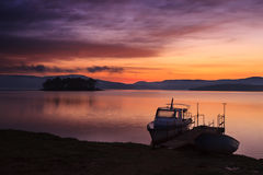 Red sunrise and boat Royalty Free Stock Photo