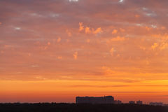 Red sunrise clouds over apartment house Stock Photography