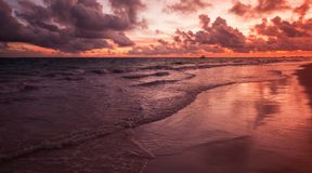 Red sunrise over Atlantic Ocean coast, Bavaro. Beach, Hispaniola Island. Dominican Republic, coastal landscape Stock Image