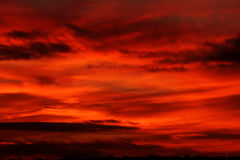 Red Sunset. Beautiful deep red cloudy sunset royalty free stock image