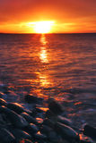 Red sunset. With soft waves Stock Photography