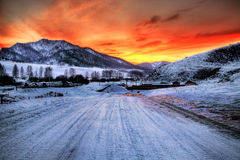 Red sunset. In winter mauntain Royalty Free Stock Images