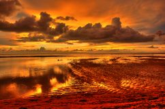 Red sunset. A red philippine sunset during low tide stock photography