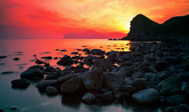Red Sunset. Sunset over a rocky coast royalty free stock images