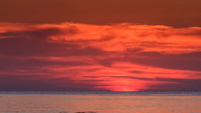 Red Sunset above Sea Sun Disk Hides behind Horizon stock footage