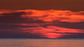 Red Sunset above Sea Sun Disk Hides behind Horizon stock video