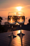 Red sunset in the beach bar. Two glasses and sunset in the beach Stock Image