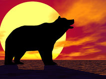 Red Sunset Bear. Bear silhouetted against a yellow sun Royalty Free Stock Photos