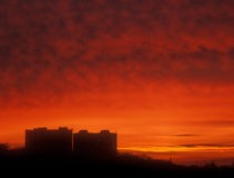 Red sunset. Beautiful red sunset over a dark cityscape Stock Photography