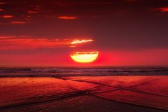 Red sunset with big sun over sea royalty free stock photos