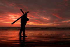 Red Sunset Cross Carry Royalty Free Stock Image