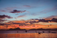 Red Sunset in El Nido, bancas in sea, Philippines. Red Sunset in El Nido, bancas in sea, Palawan, Philippines, vintage look Stock Photo