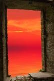 Sunset sea ancient window Stock Photos