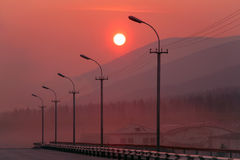 Red sunset in a haze. Royalty Free Stock Photos