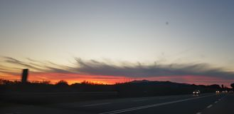 Red sunset on highway royalty free stock photo