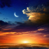 Red sunset and moon Stock Photography