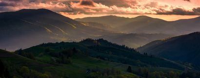 Red sunset in mountainous countryside. Gorgeous panorama of Carpathian mountains with cloudy sky in springtime Stock Photography