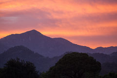 Red sunset in the mountains landscape with sunny beams Royalty Free Stock Photography