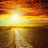 Red sunset over asphalt road Royalty Free Stock Images