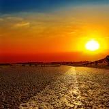 Red sunset over asphalt road Stock Image