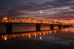 Red sunset over the bridge Stock Photo