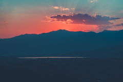 Red sunset over cloudy mountains. A red sunset over cloudy mountains Stock Images
