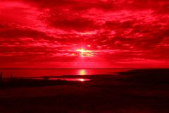 Red Sunset Over Copano Bay Texas. Red sunset in the sky over Copano Bay Texas on the gulf coast Royalty Free Stock Photo
