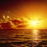 Red sunset over dark water Royalty Free Stock Photography