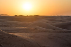 Red sunset over the dunes- Dubai Royalty Free Stock Image