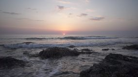 Red sunset over the Mediterranean Sea on the island of Cyprus. General plan, the red sun sets in the Mediterranean Sea on the island of Cyprus stock video footage
