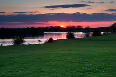 Red sunset over river in Gelderland Stock Photography
