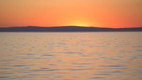 Red sunset over sea stock footage